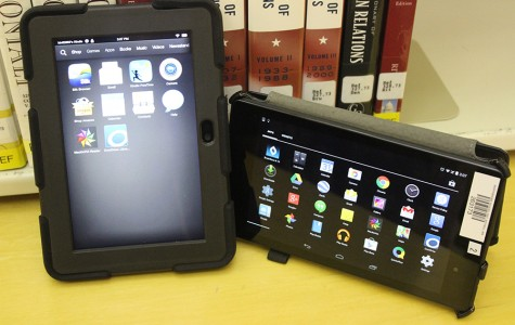 A Kindle Fire and Nexus 7 Tablet are opened to the apps pages that contain many features. Students can use the tablets to read and use online textbooks to do homework.