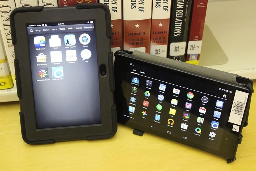 A+Kindle+Fire+and+Nexus+7+Tablet+are+opened+to+the+apps+pages+that+contain+many+features.+Students+can+use+the+tablets+to+read+and+use+online+textbooks+to+do+homework.