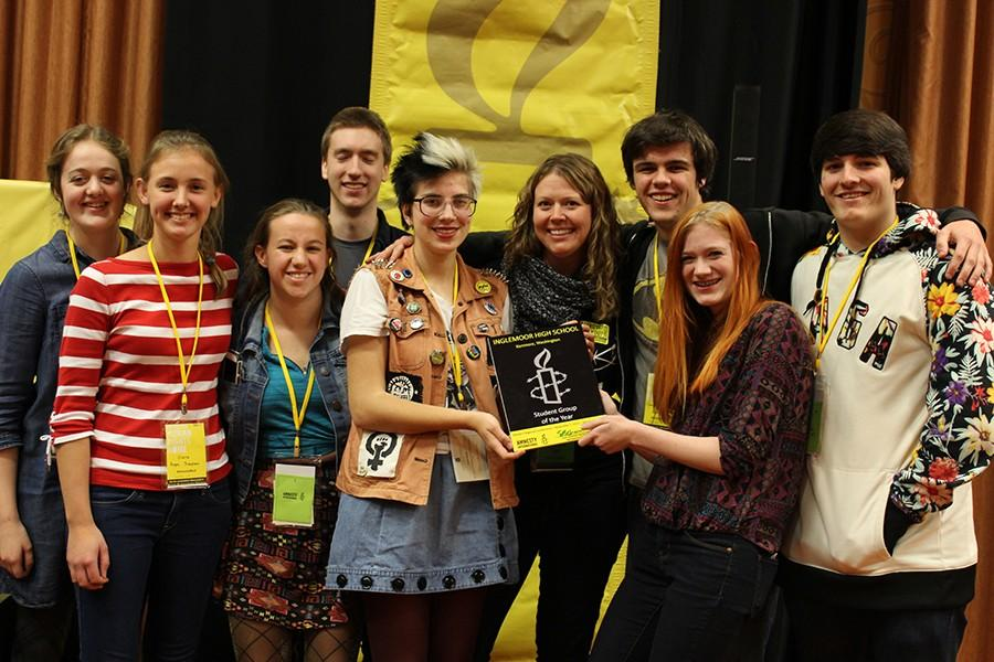 [From left to right] Junior Anna Pietsch, junior Clara Hope Simpson, senior Liz Evans, senior Graeme Fraser-Koehler, senior Peyton Carroll, field organizer Sara Schmidt, senior Christopher Colella, senior Ailish Collins, senior Nathaniel Walker proudly display the Student Group of the Year award.