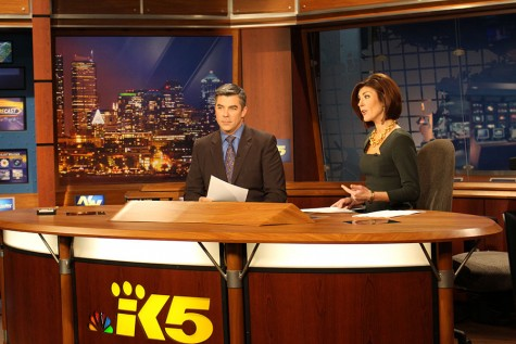 Anchors Greg Copeland and Amanda Grace sit at the King 5 news desk during the 4 p.m. news.