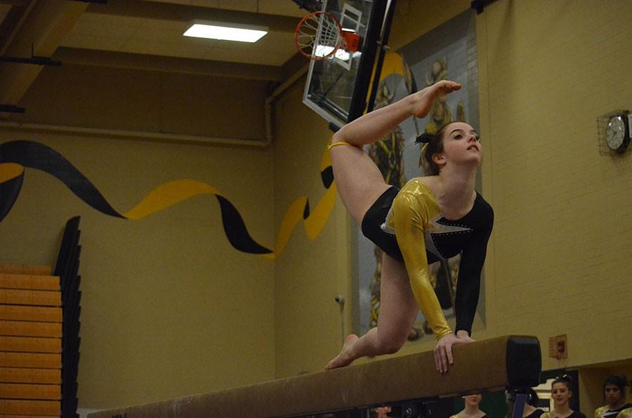 Junior Charlotte Berkman focuses on her balance during her beam routine.