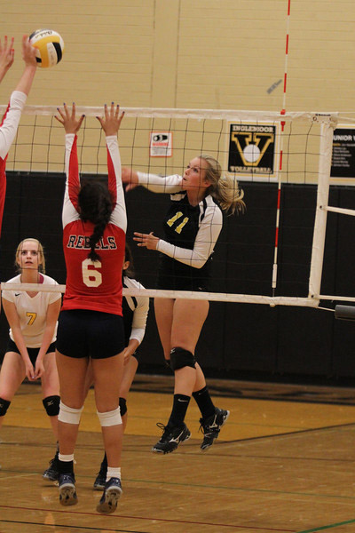Senior captain Hailey Hagstrom makes an aggressive play at the net during match at home against Juanita.