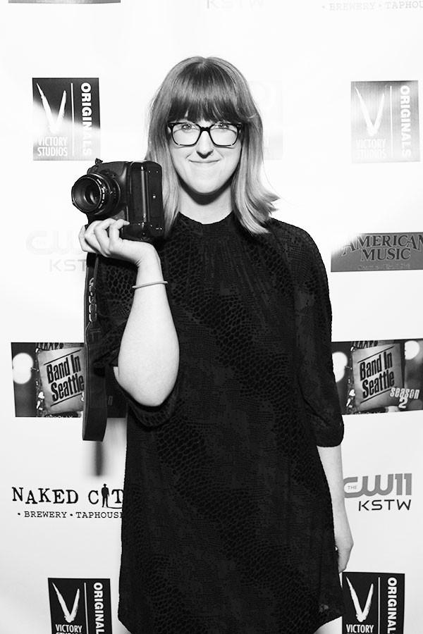 Abby Williamson poses outside of the studio with her favorite camera in hand.