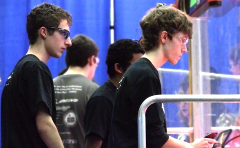 Juniors Adam Krpan, Anand Sekar and Calvin Weaver concentrate as they drive the team's robot from afar at the FIRST robotics competion at Glacier Peak High School.