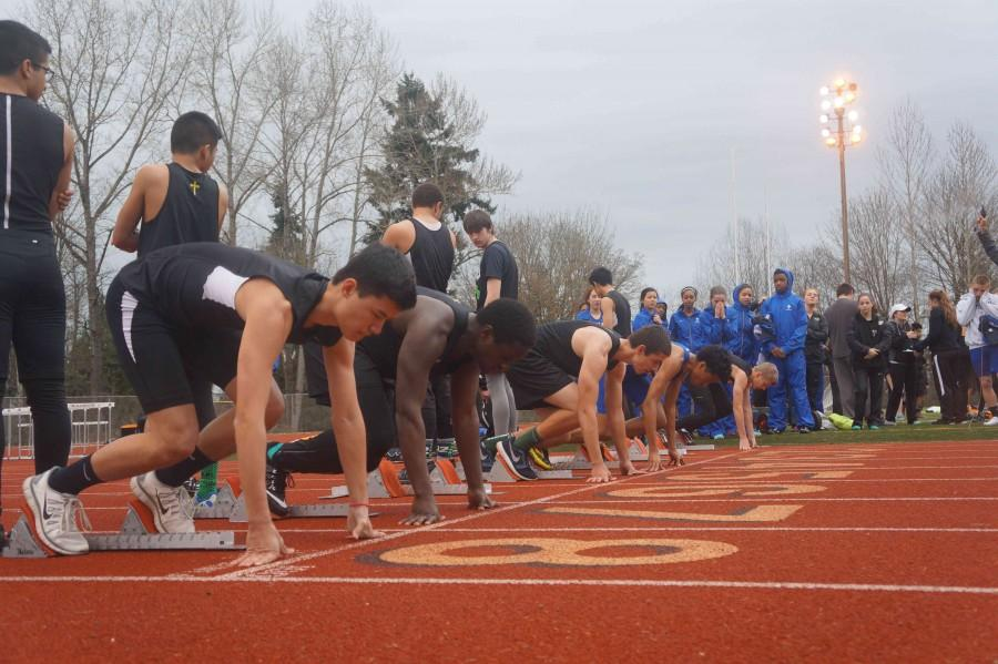 Junior Robin Takami prepares to take off from the blocks during the 100m event. He finished with a time of 12.68 seconds to place 15th at the jamboree on March 19.