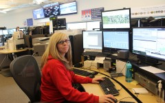 Kelly Stiefel sits at her desk, surrounded by computers and poised for action. Some of her job duties include answering 911 calls, dispatching units, running license plates, finding old records and listening to police radio.