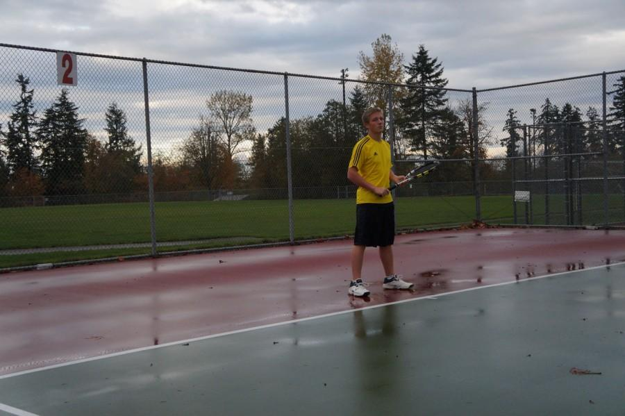 Hansen takes a break from a long tennis practice. Hansen was the first singles player on boys' tennis this year.