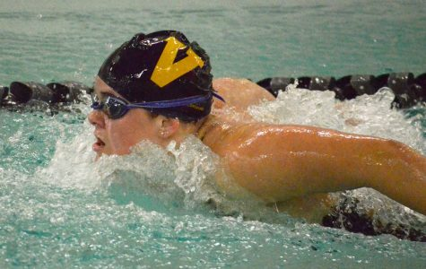 Senior Calista Skog takes a breath during the 100-yard butterfly event against Lake Washington High School. She finished in first place with a time of 1:00:06, helping secure the team's narrow victory.