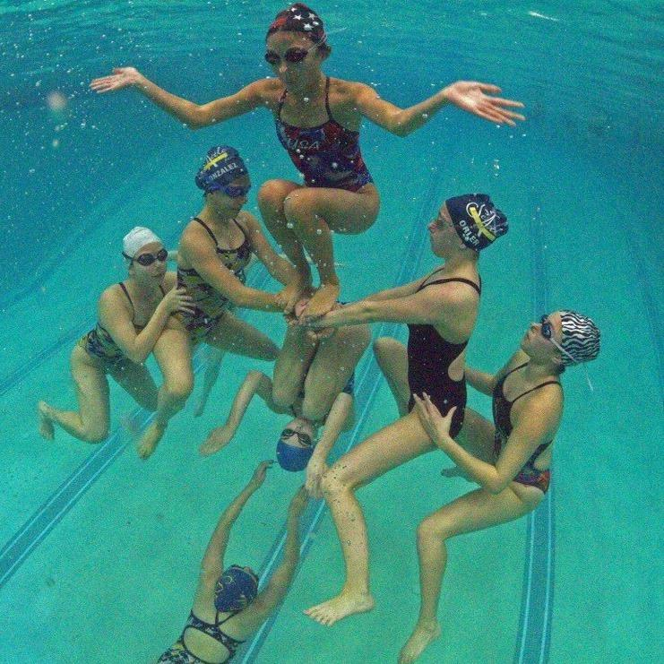 The Seattle Synchronized Swin Team prepares to execute a lift. De la Cruz's team practices five times a week in various locations throughout the Seattle area.