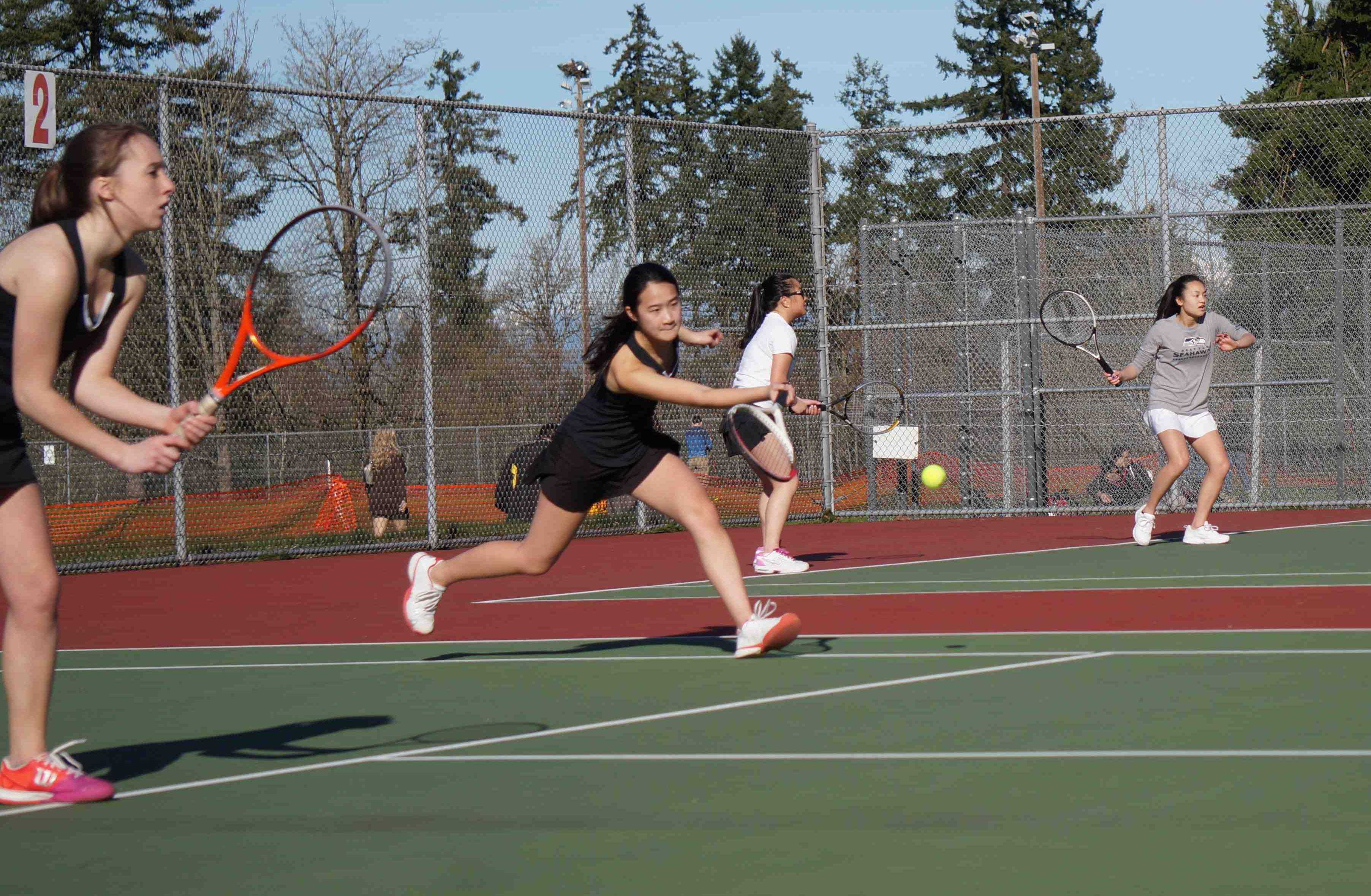 Senior co-captain Teanen Chen  focuses as she prepares to return the ball in her doubles match against Liberty High School. Chen would go on to win the match with her partner and fellow senior co-captain Kaylee Holleman. The team lost 3-4, with all of the doubles teams winning and all of the singles players losing. The girls' tennis team record is 0-2, which they seek to improve next Tuesday against Redmond.