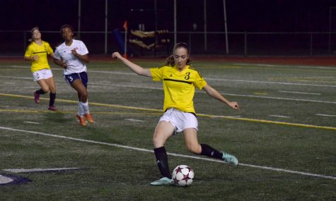 Sophomore Nicole VanEnglen maneuvers the ball away from the Inglemoor goal,  maintaining the 1-1 tie with Juanita. Inglemoor girls' soccer went on to win 1-0 against Newport.