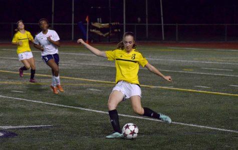 Sophomore Nicole VanEnglen maneuvers the ball away from the Inglemoor goal,  maintaining the 1-1 tie with Juanita. Inglemoor girls' soccer went on to win 1-0 against Newport.