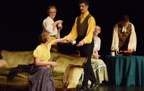 Mr. Dawson (Jacob Krieger) offers hot cider to the three dancers (Grace Hammarlund, Maddie Swift, Jessica Sparks-Stuht) after their night at the theater, while the Actor (Garrett Stanley) reads the paper.   Photo by Parker Albin