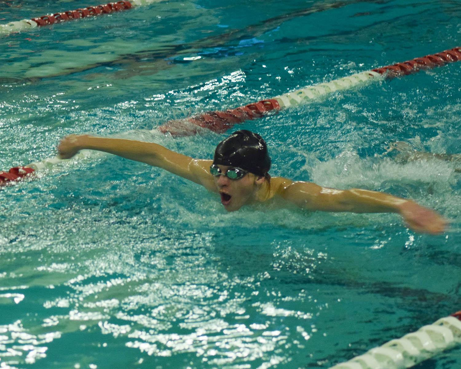 Sophomore Seth Edlund flies through the water in the 100 butterfly race at the Dec. 15 meet. His and the team's effort combined resulted in a 97-64 win against Woodinville High School.