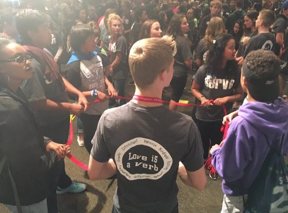 Students circle in small groups for an activity at last year's Servus Leadership Conference. Inglemoor students, athletes, and ASB advisers/officers will be attending this year's conference.