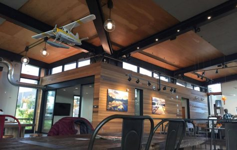 """Diva Espresso's building, """"The Hangar,"""" was aptly named; a model seaplane hangs is suspended from the ceiling of the cavernous space."""