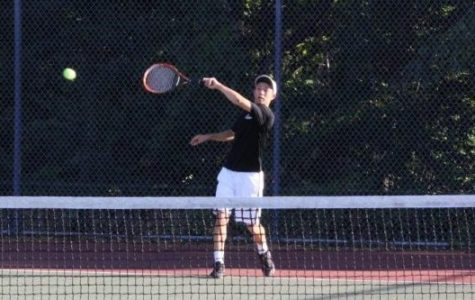Senior James Peng practices his swing.