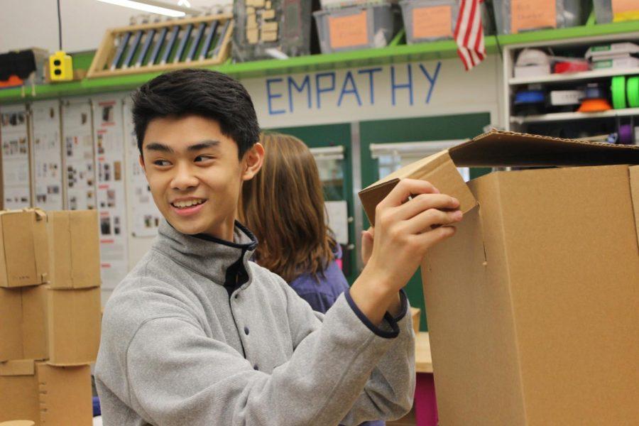 Junior Eric Ni folds his stool,