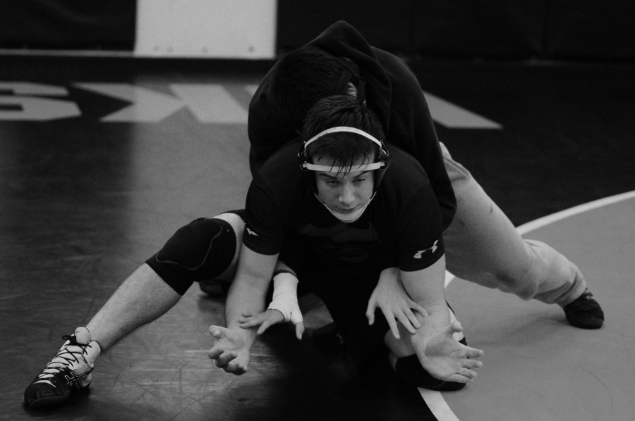 Junior Braden Dick practices with his teammate from the defensive position. They are preparing for the season ahead, with their first home meet against Newport on Jan. 4.