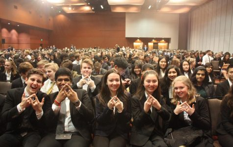 DECA members display diamond figures, mimicking the international organization's blue logo. From left to right: Andrew Jumanca, Tejas Raj, Angela Clemens, Kathryn Hill and Aleksandra Swietek. All five of these competitors qualified for the statewide competition, taking place March 1-3 in Bellevue.