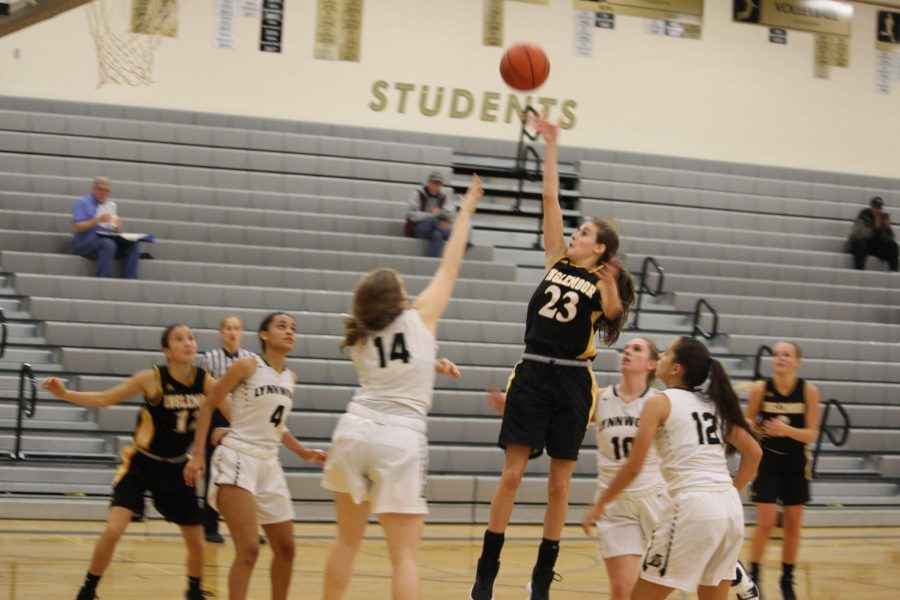 Jenna Troy drives to the basket and floats the ball over an outstretched defender.  Inglemoor went on to beat Lynwood 63-58 in their season opener.