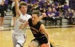 Point guard Zach Shimek drives past Issaquah defender on his way to the rim. Inglemoor boys went on to lose 67-55.