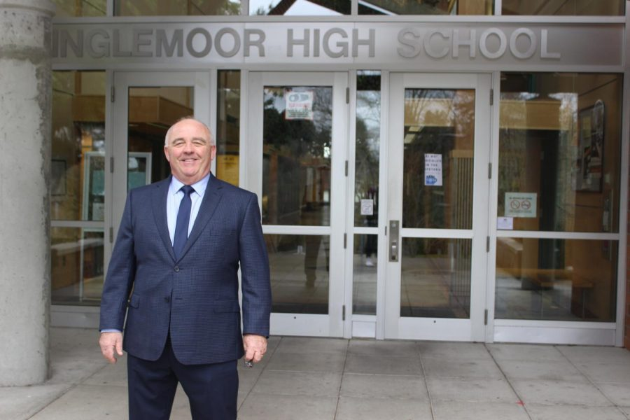 Standing outside the front doors, interim principal John Loy is on his way to go visit old friends in the office.  Loy  was assistant principal from 2000 to 2012.