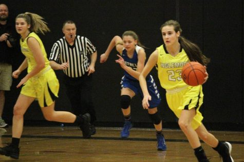 Junior Jenna Troy (far right) races downcourt against rival, Bothell High Schol. The Vikings earned a 76-58 victory.