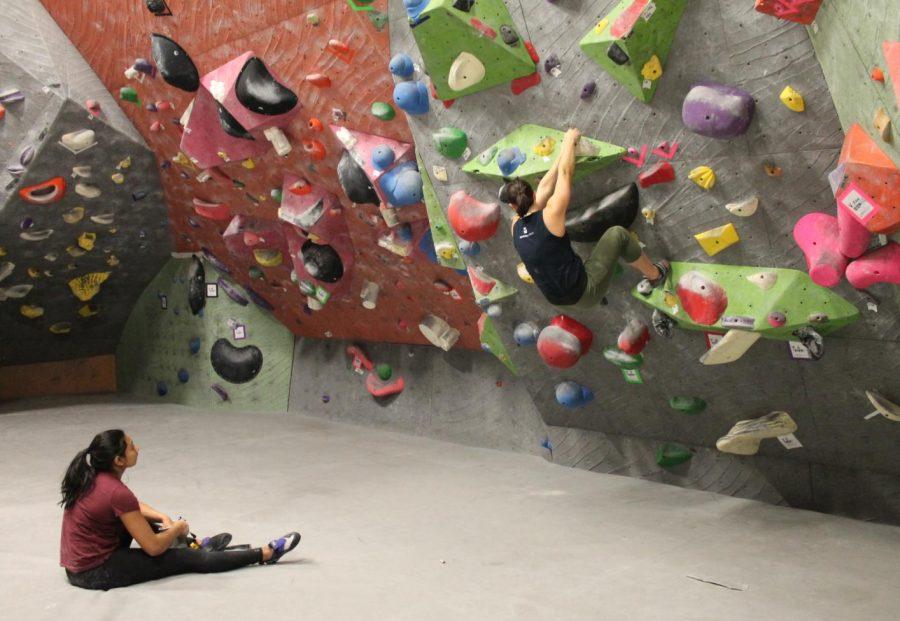 Wijeratna takes a break to watch a fellow climber at Vertical World Redmond.