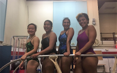 From left to right: seniors Lynn Chou, Jed Go and Tara Saleh and junior Sylvia Hendrix pose post-practice along the diving board.