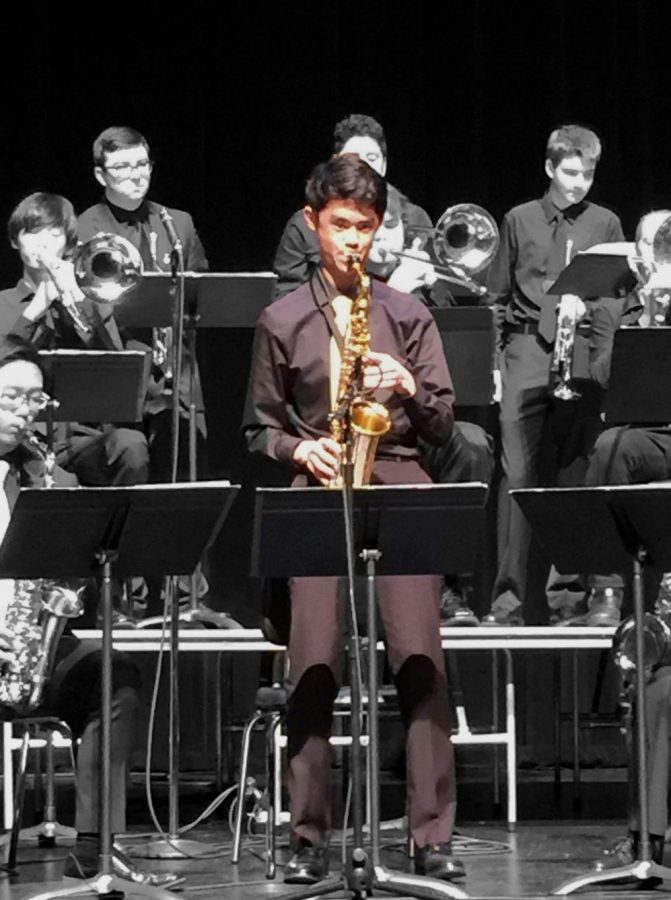 Eric Ni plays a solo on his saxophone during jazz band.