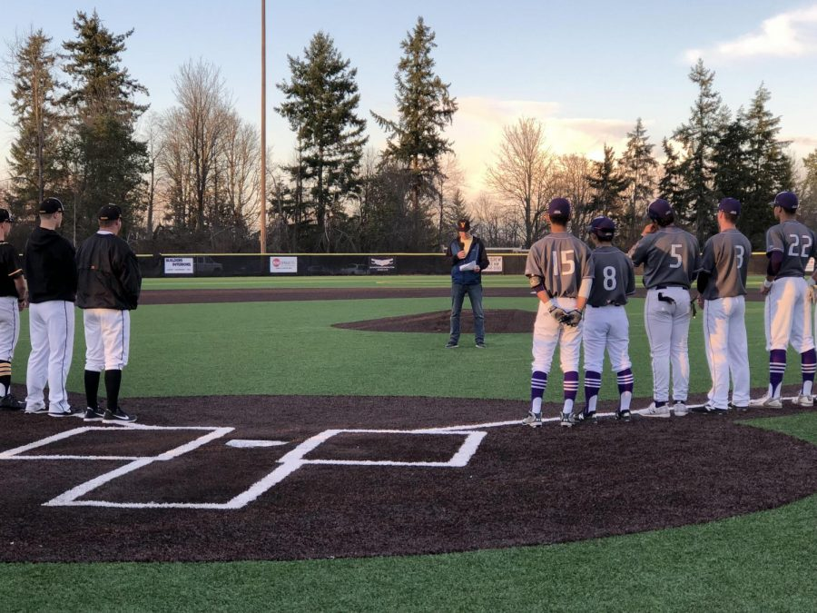 IHS and LWHS players line up along the baselines during the Justin Marshall memorial ceremony at Inglemoor, honoring Justin's life and dedication on March 16.