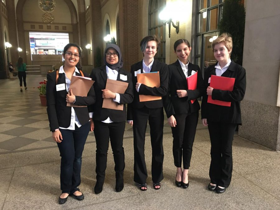 Left to right: All smiles in their matching outfits, Ishika Kaushik, Andhisty Mahmud, Ally Ellet, Priya Hendry and Sophia McDaniel walk into the Federal Reserve Building of New York to compete in the Euro Challenge. After their presentation, the girls toured around New York City.