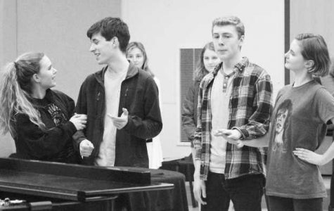 Actors practice for the musical.