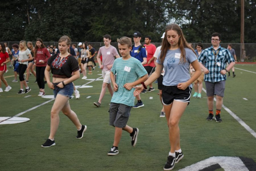 Along with the rest of the band, senior Gisèle Charpentier, freshman Luke Knight, and senior Hannah Wiggins  (fourth member of this squad not pictured) do the pinwheel together. Its important to be connected and look like youre having fun because then you look good and mistakes dont look as bad, Wiggins said.