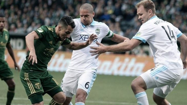 Portland+Timbers%E2%80%99+midfielder+Sebastian+Blanco+fights+for+the+ball+against+Seattle+Sounders%E2%80%99+midfielder+Osvaldo+Alonso+%28left%29+and+defender+Chad+Marshall+%28right%29.+Image+via+ESPN.