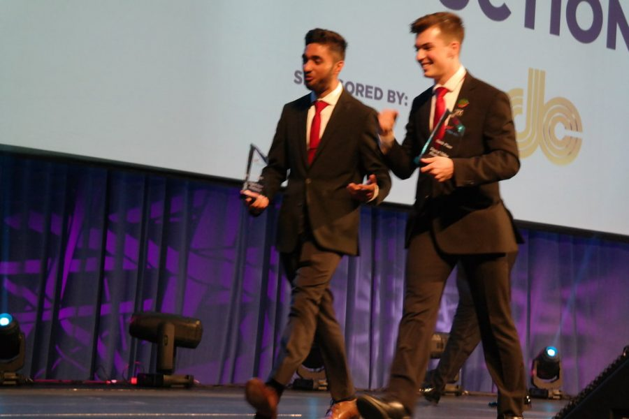 Senior Rajbir Singh and senior Tom Mikolyuk walk off the stage after receiving 6th place in Digital Video Production.