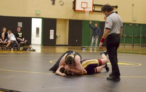 JV wrestler and freshman Xander Alston pins his opponent at a meet with Issaquah on Dec. 6. Alston won this match, but ultimately Inglemoor lost the meet, leaving their standing at 0-2.