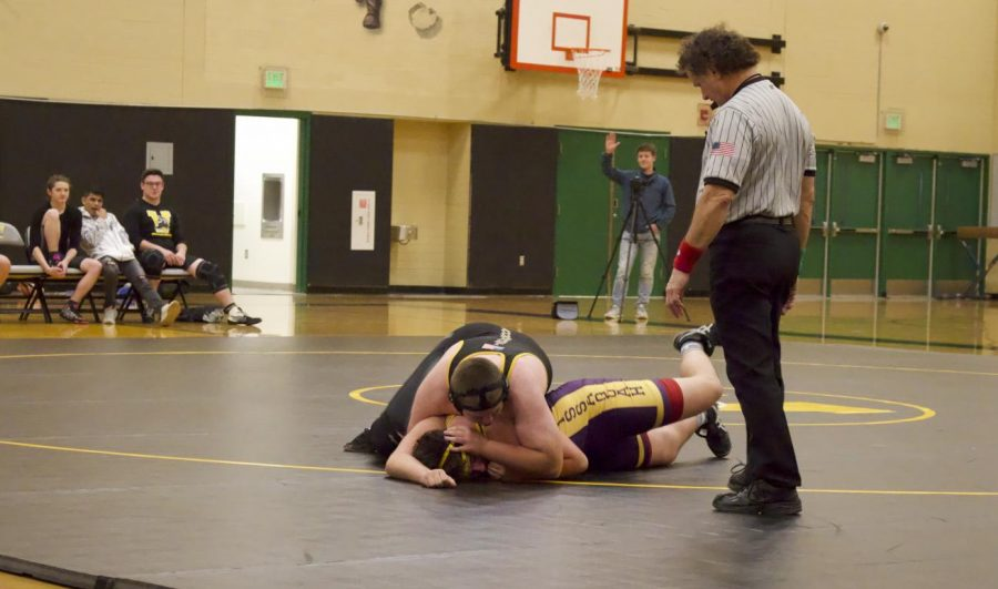 JV+wrestler+and+freshman+Xander+Alston+pins+his+opponent+at+a+meet+with+Issaquah+on+Dec.+6.+Alston+won+this+match%2C+but+ultimately+Inglemoor+lost+the+meet%2C+leaving+their+standing+at+0-2.