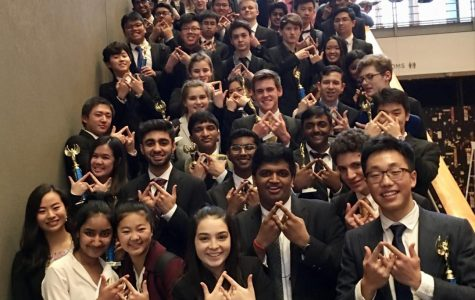 Students hold up the DECA symbol at Meydenbauer Center.