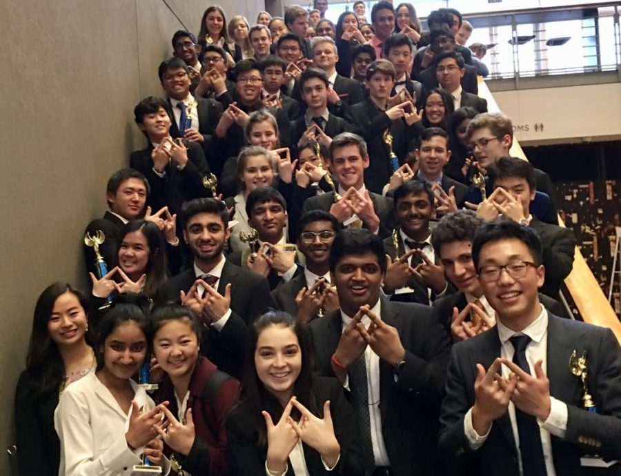 Students+hold+up+the+DECA+symbol+at+Meydenbauer+Center.++%22Inglemoor+DECA+exceeded+my+expectations+this+year%2C%22+Xie+said.
