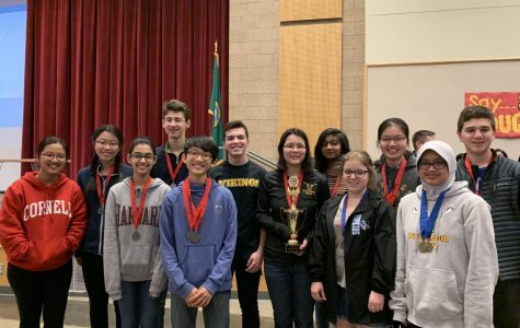 The Valhalla Team pose with their trophy after the award ceremony. Only the top three teams receive trophies. From left to right: senior Gloria Shi, junior Melissa Mitchell, freshman Harshini Iyer, freshman Ryan Nelson, junior Christopher Lee, senior Tom Mikolyuk, junior Karen Haining, sophomore Ashi Jain, senior Anna Weaver, senior Sandy Cheng, sophomore Nandira Mahmud and junior Conor Bartol. Not pictured: Kevin Shi.