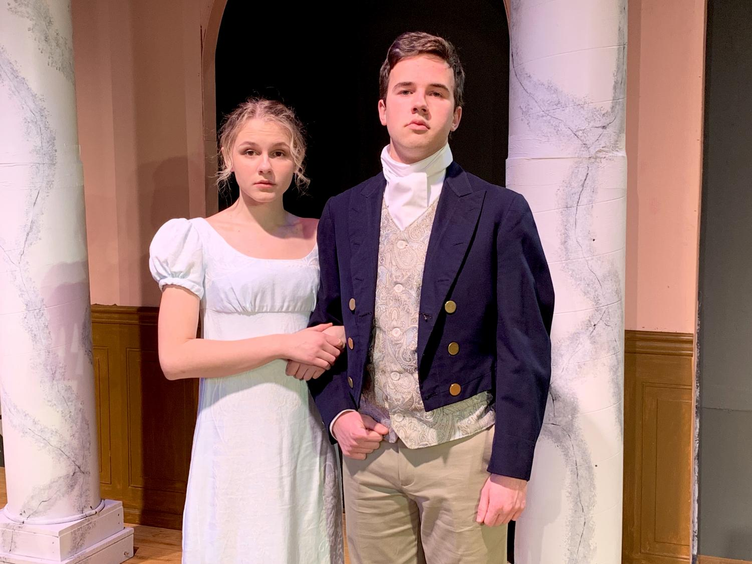 Sophomore Daisy Held and junior Sam Trott link arms in full costume as Elizabeth Bennet and Mr. William Darcy, respectively.