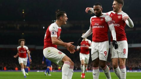 Alexandre Lacazette celebrates first goal of the game with teammates Granit Xhaka (left) and Aaron Ramsey (right) in the 14th minute.