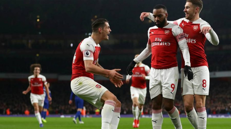 Alexandre+Lacazette+celebrates+first+goal+of+the+game+with+teammates+Granit+Xhaka+%28left%29+and+Aaron+Ramsey+%28right%29+in+the+14th+minute.