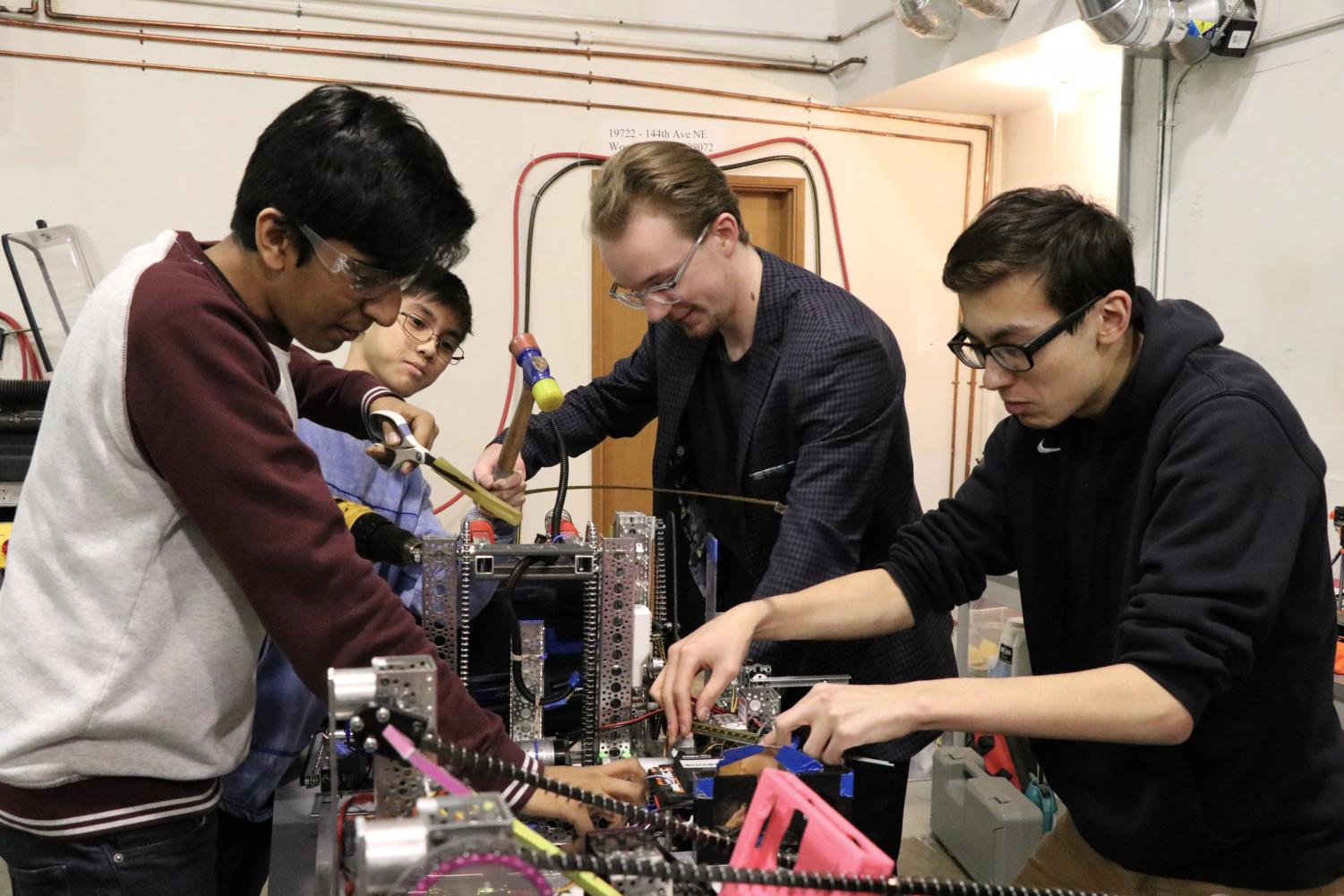 Jones works on the scoring mechanism on this team's robot before the FTC State Championships on March 17.