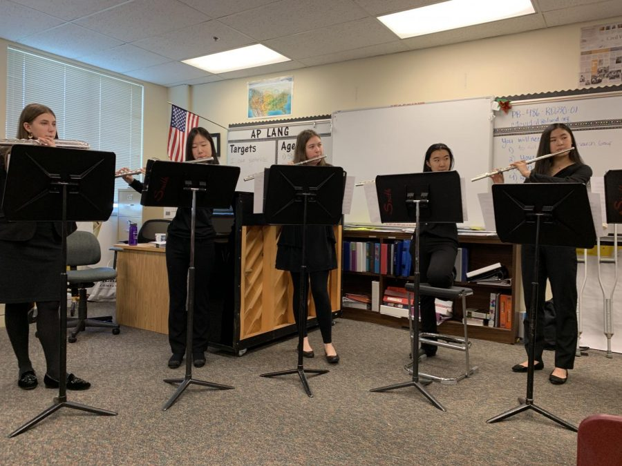 Five of Inglemoor's senior flutists competed as a quintet named Inglemoor HS Flute Choir on Saturday, March 2. Winning the Northlake regional in the Large Woodwinds category, they will be moving on to the final state competition on April 26. From left to right: Beatrice Duchastel de Montrouge, Rachel Chang, Alexandra Reed, Evelynn Li and Anna Li.
