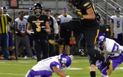 """Quentin Moore jumps over another player at the 2018 homecoming game against North Creek. Moore described this moment as """"his favorite highlight of the season."""""""