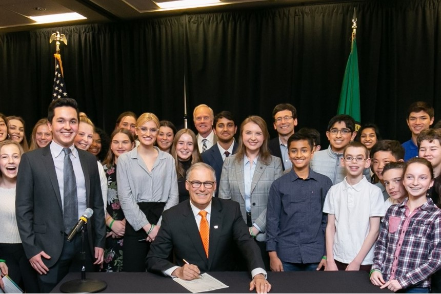 On April 1, Gov. Jay Inslee signed the T21 bill at the Fred Hutch building in Seattle.