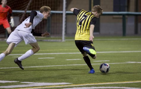 """Forward Gabe Fahling shoots towards the goal in the first half of the game against Eastlake on March 27, although it eventually got saved. """"[The coach] wants us to get more counter attacks,"""" Fahling said. """"We want to defensively try to win the ball back more."""""""